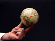 Man Holding World Globe in Color Stock Photo
