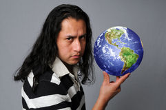 Man holding world in hand Stock Images