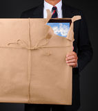 Man Holding Wrapped Frame With Torn Corner Stock Photo