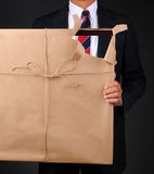 Man Holding Wrapped Frame With Torn Corner Stock Images