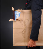 Man Holding Wrapped Frame With Torn Corner Royalty Free Stock Photo