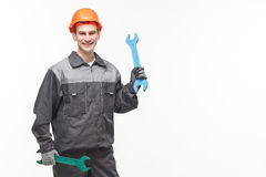Man holding wrench isolated on white background Royalty Free Stock Photo