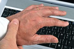 Carpal tunnel pain in close up. Man holding wrist because of carpal tunnel pain stock photos