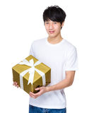 Man holding xmas present Royalty Free Stock Image