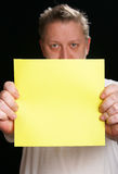 Man holding yellow blank cardboard Stock Photos