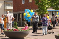 A man holding yellow and blue balloons on the celebration of Swedens national day. Celebrations of Swedens national day June 6th 2016. Munkfors, Sweden stock photos