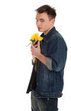 Man holding a yellow roses Royalty Free Stock Photography