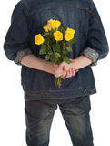 Man holding a yellow roses Stock Photo