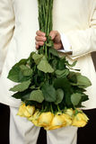 Man holding yellow roses Royalty Free Stock Image
