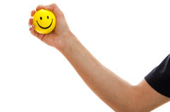 Man holding a yellow smiley emoticon Stock Image