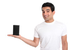 Man holding your merchandise product. A man holds your merchandise retail product in the palm of his hand. He is dressed in a white t-shirt and is smiling. Add Royalty Free Stock Photography