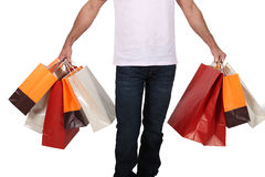 Man holdingshopping bags Royalty Free Stock Images