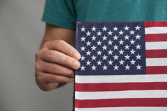 Man Holds American Flag Stock Photography