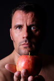 Man holds an apple. In his hands Royalty Free Stock Photo