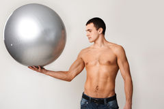 Man holds ball Royalty Free Stock Image