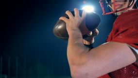 American football player with sporting equipment, close up. stock video footage