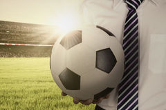Man holds a ball and wearing formal suit Stock Photos