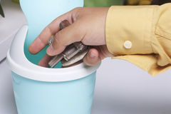 The man holds the batteries in his hand. Royalty Free Stock Photography