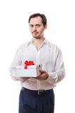The man holds a beautiful gift in hand. The man holds the beautiful box with a gift which is tied up by a bow in hand stock photo