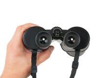 Man holds binoculars Stock Photography