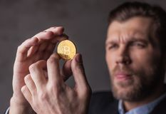 Man holds bitcoin in hands Stock Image
