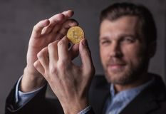 Man holds bitcoin in hands Stock Photos