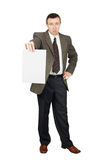 Man holds a blank sheet of paper Stock Images