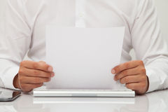Man holds blank sheet of paper in hands Stock Images