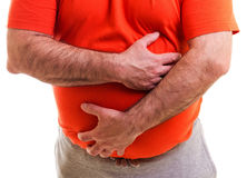 Man holds both hands on his aching stomach Stock Photography