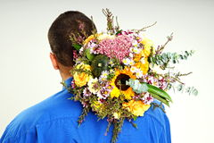 Man holds bouquet of flowers for the head stock photo