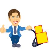 Man holds a cart with a load Royalty Free Stock Images