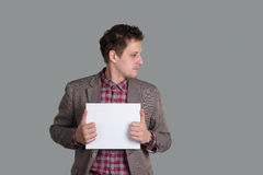 the man holds a clean sheet of paper Stock Photography