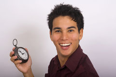 Man holds a clock in his hand Royalty Free Stock Photo