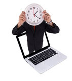 Man holds clock in laptop Royalty Free Stock Photo
