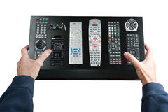 Man holds a complex remote control Stock Photography