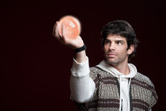 Man Holds a Crystal Ball Stock Photos