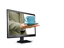 Man holds a cup from the monitor Royalty Free Stock Images