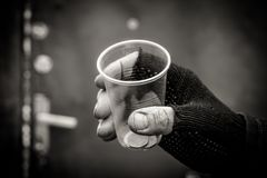 Casque. A man holds a Cup in an outstretched hand Stock Image