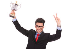 Man holds cup & victory sign Stock Photography