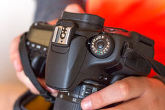 A man holds a digital camera Stock Image