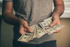 A man holds dollars in his hands Royalty Free Stock Images