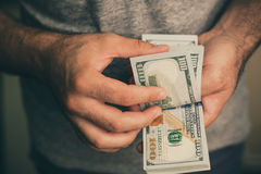 A man holds dollars in his hands Stock Image