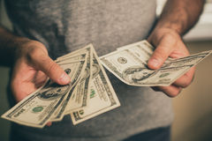 A man holds dollars in his hands Stock Photography