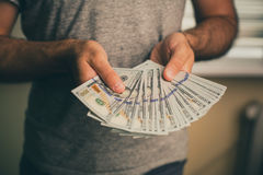 A man holds dollars in his hands Stock Photo