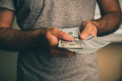 A man holds dollars in his hands Stock Images