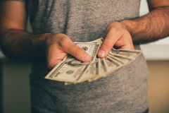 A man holds dollars in his hands Royalty Free Stock Photo