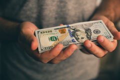 A man holds dollars in his hands Royalty Free Stock Image