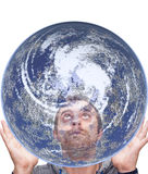 Man holds the earth and look up Stock Image