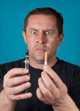 Man holds electric and ordinary cigarette Royalty Free Stock Photo