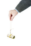 Man holds a fishing hook with dollar banknotes as a bait Royalty Free Stock Photo